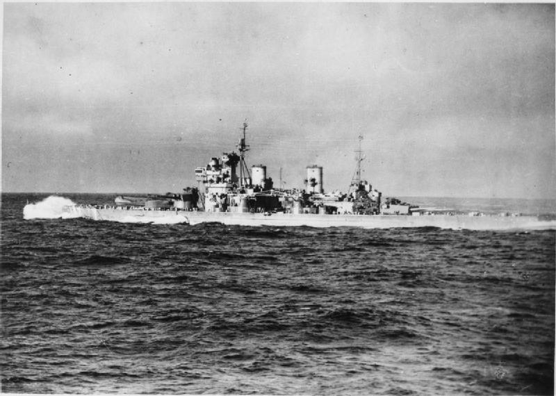 Waves crashing over the bow, HMS Duke of York steaming at 20 to 25 knots during an Arctic convoy to Russia (photographed from the aircraft carrier HMS Victorious).*